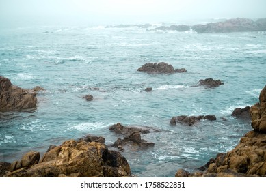 Stormy turquoise sea with waves crashing on the rocks in the misty morning.stromy sea rock  - Shutterstock ID 1758522851