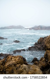 Stormy turquoise sea with waves crashing on the rocks in the misty morning.stromy sea rock  - Shutterstock ID 1758522854