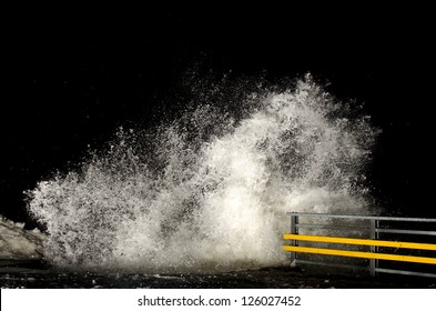 Stormy weather and breaking waves at night