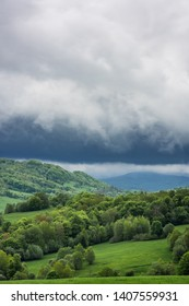 Stormy weather with dramatic rainy clouds over green peaks in Carpathian Mountains, Bieszczady,Poland.