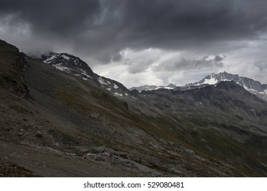 Stormy weather in the mountains with dark clouds