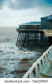 Stormy weather on Blackpool pleasure beach, North pier during rain and tide, September 2010 England UK, Blackpool