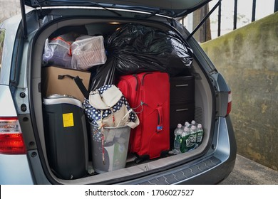 Storrs, CT / USA - March 19, 2020: Minivan packed to the brim with stuff on moving day