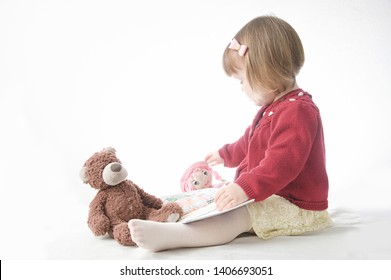 Story time. Little girl playing school with toys teddy bear and doll.  children education and development, happy childhood