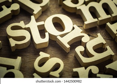 Story word in random alphabets scattered on wood table, storytelling concept
