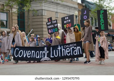 Stoughton, Wisconsin, USA - May 19, 2018: Syttende Mai Youth Parade, Members of the Covenant Lutheran Church, dress up as jedi knights, promoting peace, joy, and good