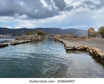 Stoun bridge over canal , Elounda peninsula, Crete Island, Greece