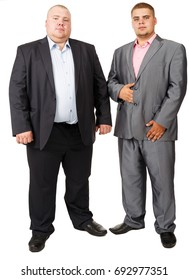 Stout Person. White isolated background. Fat man. Two fat man standing belly a together on white background. Two fat guy in suits. Portrait of two fat brothers. Official clothes. Russian businessmen.