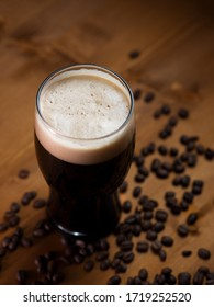 stout or porter with coffee on a wooden pub table