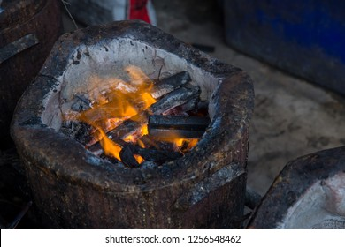 stove charcoal.orange flames of coals in the grill / Charcoal stove burning.Brazier charcoal burning ready to grill in solid stove,feel cliam and warm at night.