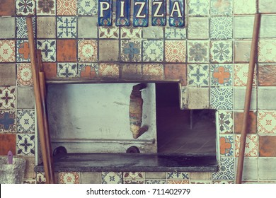 Stove decorated ceramic tiles with oriental ornaments and the inscription PIZZA. Toned