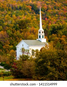Stowe Community Church, Stowe, VT.  The church is surrounded by trees with autumn colored leaves