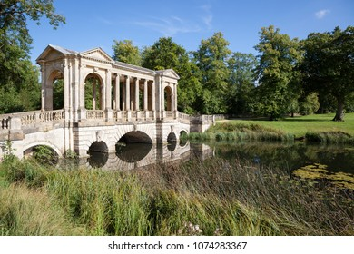 STOWE, UK - AUGUST 25, 2017: The Palladian Bridge over a lake in Stowe Landscape Gardens on a sunny day.