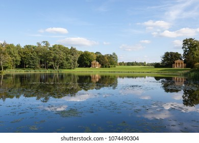 STOWE, UK - AUGUST 25, 2017: View of lake and temples in Stowe Landscape Gardens on a sunny day.
