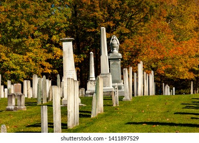 Stowe, Vermont - 10/6/2007: A graveyard with a backdrop of Autumn colors near Stowe, VT.