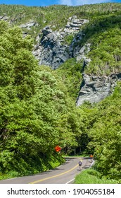 Stowe, VermontUSA-June 29, 2007: Bicycle riders tackle a difficult uphill climb on the Mountain Road leading into Smugglers' Notch in the Stowe area of northern Vermont. High rock cliffs are shown.