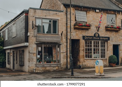Stow-on-the-Wold, UK - July 10, 2020: Row of independent shops on a street in Stow-on-the-Wold, a market town in Cotswolds, UK, build on Roman Fosse Way.