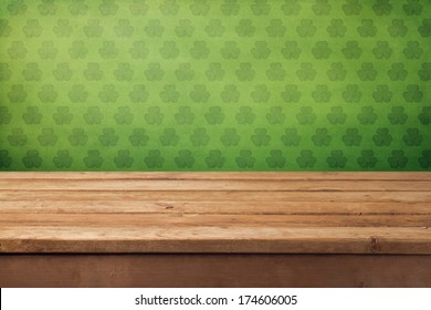 St.Patrick's day background with empty wooden table and wallpaper