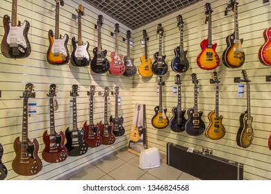 St.Petersburg - December 6, 2018. Electric guitars hanging on wall in a  musical shop