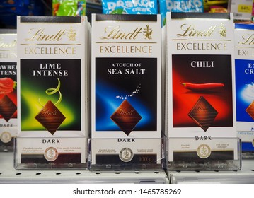 St.Petersburg, Russia. 07.30.2019. Lindt Exellence assorted chocolate bars on the supermarket shelf. Lindt is a Swiss chocolatier and confectionery company known for its chocolate truffles and bars.