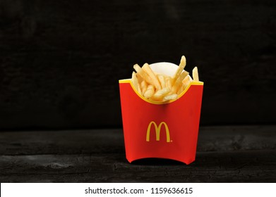 St.Petersburg, Russia - 12 August 2018: McDonald's meal on rutic black background, includes French Fries potato