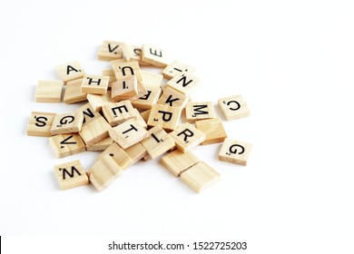 St.Petersburg Russia, 29.06.2019: Board game concept. Wooden Scrabble letter tiles on white background.