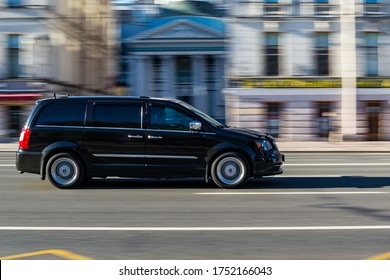 St.Petersburg, Russia, 30/05/2020: black minivan in motion with blurred background. black car in motion.