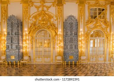 ST.PETERSBURG, RUSSIA - AUGUST 19, 2017: Ornate interior of the Catherine Palace with gilded details, large mirrors and windows. Tsarskoe Selo (Pushkin), 30 km south of Saint- Petersburg, Russia.