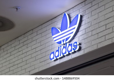 St.Petersburg, Russia - August 2019. Adidas logo in the large supermarket