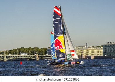 ST.PETERSBURG, RUSSIA - AUGUST 21, 2015:  Red Bull Team and Oman (The Wave) Team on the 6th act of Extreme Sailing Series race