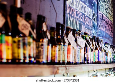 St-Petersburg, Russia - December 10, 2016: Various types of bottled beer are displayed on shelf in a bar in St-Petersburg, Russia. Menu on the background