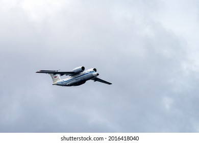 """ST.PETERSBURG, RUSSIA - Jul 22, 2021: The Russian Navy STOL twin jet transport aircraft Antonov An-72 (NATO reporting name: Coaler) """"blue 42"""" take part in the dress rehearsal of the Main Naval Parade."""