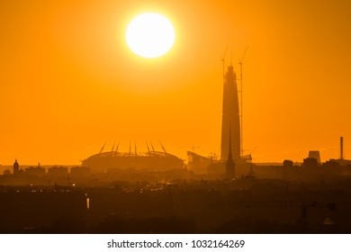St.Petersburg/ Russia - July 16 2017: Central. Peter and Paul Fortress is on the same line as the new business center, the skyscraper Lahta Center of Gazprom, football arena for 2018 World Cup. Sunset