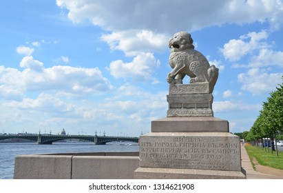 ST-PETERSBURG, RUSSIA - JULY 20, 2014 - Ancient Chinese (Manchurian) sculpture Shih Tsza lion on Petrovskaya quay of Neva river in St. Petersburg, Russia