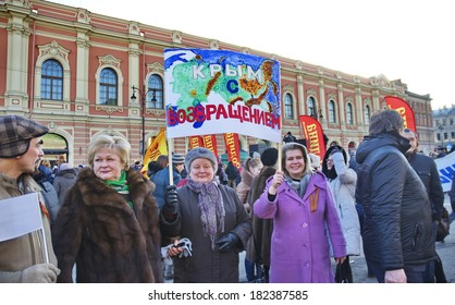 St.Petersburg, RUSSIA - MARCH 18: Meeting devoted to  Crimea and Sevastopol jojning Russian Federation on Konyushennaya Square in St.Petersburg on March 18, 2014, in St.Petersburg, Russia