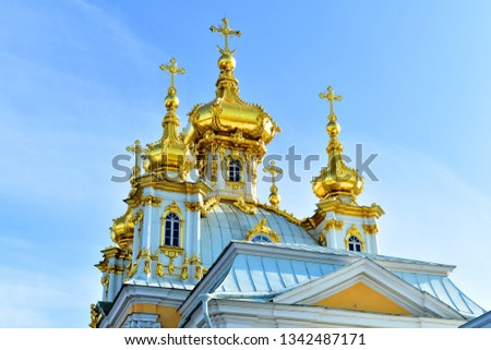 St.Petersburg Russia March 2019 Golden anion shape domes. Grand Palace Church Peterhof