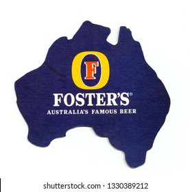 ST-PETERSBURG, RUSSIA - MARCH 3, 2019 - Vintage coaster (beer mat) with ad of Foster's beer.  Isolated on white background