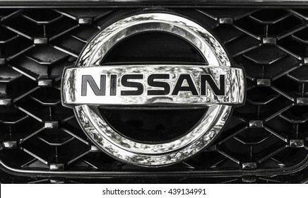 St-Petersburg, Russia - May 15, 2016: Nissan car logo on a front radiator grille of Nissan X-Trail SUV, closeup photo with selective focus