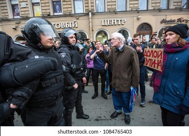 ST.PETERSBURG, RUSSIA - MAY 5, 2018: Police officers in riot gear block an Nevsky prospect during an opposition protest rally ahead of Vl.Putin's inauguration ceremony (Inscription: Putin remove )