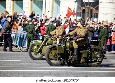 "ST.PETERSBURG, RUSSIA: - MAY 9, 2015: The person in the form of the Soviet soldier on the military motorcycle of times of World War II. The action ""immortal regiment"" in honor of a Victory Day."
