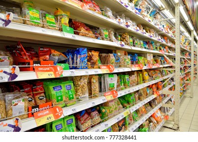 ST.PETERSBURG, RUSSIA - OCTOBER 16, 2017:  Market stalls Packed with nuts and dried fruits in hypermarket Karusel