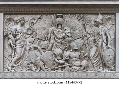 ST.PETERSBURG, RUSSIA - SEP 11:The pedestal of the Alexander Column is decorated with symbols of military glory, sculpted by Giovanni Battista Scotti, in St.Petersburg, Russia on Sep 11, 2012