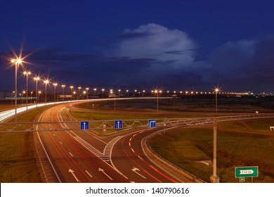 ST-PETERSBURG, RUSSIA - SEPTEMBER 17: Ringway St Petersburg, September 17, 2009. The mast lighting on the night road. Electric lights in the night highway. Road lighting lanterns. Russian roads.