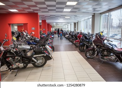 ST.PETERSBURG, RUSSIA-CIRCA DEC, 2018: Men chooses used motorcycles in showroom of the Megamoto store. Megamoto is Russian largest company for bikes, motorcycle clothing and accessories