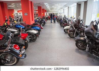 ST.PETERSBURG, RUSSIA-CIRCA DEC, 2018: People choose used motorcycles in sotrage of the Megamoto shop. Megamoto is Russian largest company for bikes, motorcycle clothing and accessories