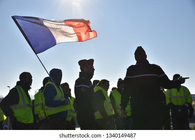 St.Pol-sur-Ternoise, Hauts-de-France/France-November 17, 2018: Gilets Jaunes (Yellow Vest) Protestors blockade at the roundabout north of St.Pol-sur-Ternoise in protest at Macron's austerity policy.