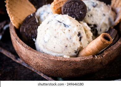 Stracciatella homemade ice cream and cookies in the wooden bowl,selective focus