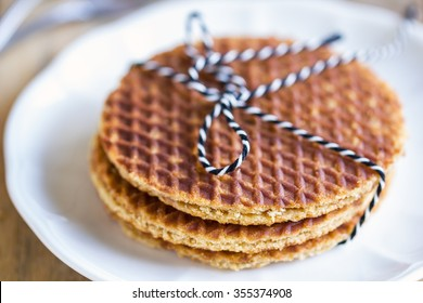 Strack of Traditional Dutch waffle called Stroopwafel on a dish
