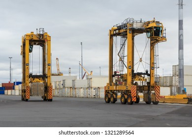 Straddle Carriers in a Port. These Huge Vehicles Move and Stack Cargo Containers by Driving Over Them and Carrying the Load Underneath