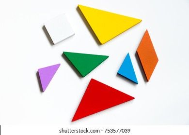 Straggled tangram puzzle  wait to complete the shape on white background